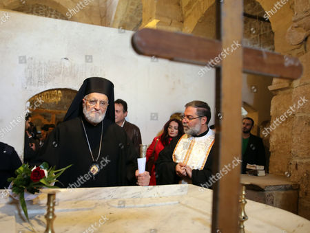 Gregory Iii Laham (l) the Patriarch of Antioch and All the East Visits the Greek Catholic Monastery of St Sergius and Bacchus in the Small Town of Maaloula Syria 20 December 2014 Journalists Have Been Taken in a Government-organized Tour to the Ancient Christian Town on 20 December 2014 to Oversee the Display of Rare Icons and Relics That Were Stolen by Militants and Recently Restored by the Government at the Greek Catholic Monastery of St Sergius and Bacchus Many Works of Art and Historic Relics Were Robbed From the Monastery Including the Invaluable Icon of St Sergius Painted in the 13th Century Syrian Arab Republic Maaloula