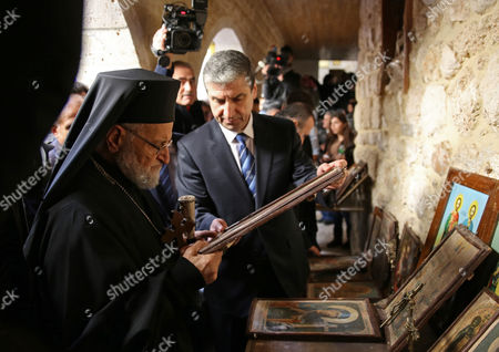 Gregory Iii Laham (l) the Patriarch of Antioch and All the East is Shown Relics and Icons by Syrian Minister of Education Issam Khalil (c) at the Greek Catholic Monastery of St Sergius and Bacchus in the Small Town of Maaloula Syria 20 December 2014 Journalists Have Been Taken in a Government-organized Tour to the Ancient Christian Town on 20 December 2014 to Oversee the Display of Rare Icons and Relics That Were Stolen by Militants and Recently Restored by the Government at the Greek Catholic Monastery of St Sergius and Bacchus Many Works of Art and Historic Relics Were Robbed From the Monastery Including the Invaluable Icon of St Sergius Painted in the 13th Century Epa/youssef Badawi Syrian Arab Republic Maaloula