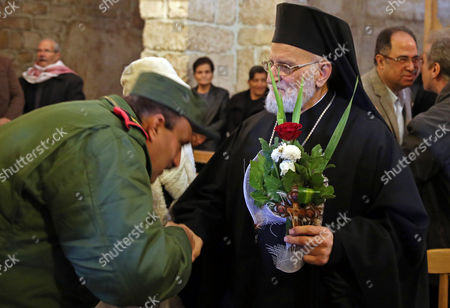 Syrian Soldiers Pay Their Repect to Gregory Iii Laham (r) the Patriarch of Antioch and All the East at the Greek Catholic Monastery of St Sergius and Bacchus in the Small Town of Maaloula Syria 20 December 2014 Journalists Have Been Taken in a Government-organized Tour to the Ancient Christian Town on 20 December 2014 to Oversee the Display of Rare Icons and Relics That Were Stolen by Militants and Recently Restored by the Government at the Greek Catholic Monastery of St Sergius and Bacchus Many Works of Art and Historic Relics Were Robbed From the Monastery Including the Invaluable Icon of St Sergius Painted in the 13th Century Epa/youssef Badawi Syrian Arab Republic Maaloula
