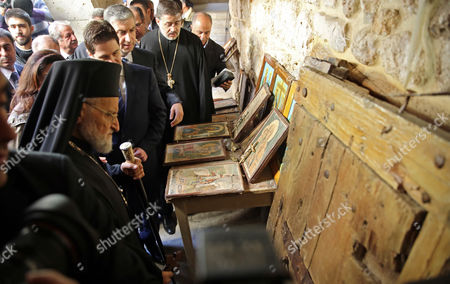 Stock Picture of Gregory Iii Laham (l) the Patriarch of Antioch and All the East is Shows Relics and Icons at the Greek Catholic Monastery of St Sergius and Bacchus in the Small Town of Maaloula Syria 20 December 2014 Journalists Have Been Taken in a Government-organized Tour to the Ancient Christian Town on 20 December 2014 to Oversee the Display of Rare Icons and Relics That Were Stolen by Militants and Recently Restored by the Government at the Greek Catholic Monastery of St Sergius and Bacchus Many Works of Art and Historic Relics Were Robbed From the Monastery Including the Invaluable Icon of St Sergius Painted in the 13th Century Epa/youssef Badawi Syrian Arab Republic Maaloula