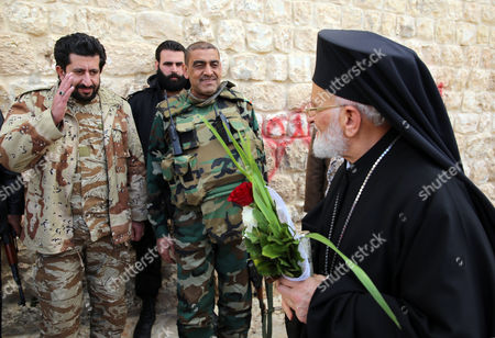 Stock Photo of Syrian Soldiers Pay Their Repect to Gregory Iii Laham (r) the Patriarch of Antioch and All the East at the Greek Catholic Monastery of St Sergius and Bacchus in the Small Town of Maaloula Syria 20 December 2014 Journalists Have Been Taken in a Government-organized Tour to the Ancient Christian Town on 20 December 2014 to Oversee the Display of Rare Icons and Relics That Were Stolen by Militants and Recently Restored by the Government at the Greek Catholic Monastery of St Sergius and Bacchus Many Works of Art and Historic Relics Were Robbed From the Monastery Including the Invaluable Icon of St Sergius Painted in the 13th Century Epa/youssef Badawi Syrian Arab Republic Maaloula