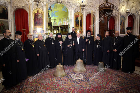 Stock Photo of Patriarch of Antioch and All the East Gregory Iii Lahamd (c) Stands with Clergymen Next to Three Recovered Bells at the Cathedral of Our Lady of Al-niyah For Greek Melkite Catholics in Damascus Syria 26 May 2015 According to Media Reports the Bells Were Stolen by Armed Groups From the Archaeological Churches in Maaloula and Yabroud in the Countryside of Damascus Syrian Arab Republic Damascus