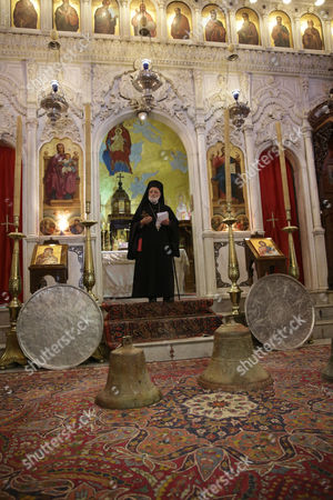 Patriarch of Antioch and All the East Gregory Iii Lahamd Prays During a Ceremony For Handing Over Three Recovered Bells at the Cathedral of Our Lady of Al-niyah For Greek Melkite Catholics in Damascus Syria 26 May 2015 According to Media Reports the Bells Were Stolen by Armed Groups From the Archaeological Churches in Maaloula and Yabroud in the Countryside of Damascus Syrian Arab Republic Damascus