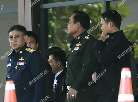 Thai Army Chief General Prayut Chan-o-cha (2-r) Walks with Air Chief Marshall Prachin Chantong (l) As They Leave After a Meeting Between the Army and the Main Political Rivals on Second Day in Bangkok Thailand 22 May 2014 Thai Army Chief Prayut Chan-o-cha Announced a Coup After His Efforts to Reconcile Rival Political Factions Failed the Talks Which Started a Day Earlier Were the First Since Anti-government Protests Broke out in Early November Thailand Bangkok