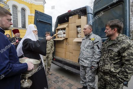 Patriarch Filaret (2-l) the Leader of the Ukrainian Orthodox Church of the Kyiv Patriarchate Blesses Volunteers and Traditional Easter Cakes to Be Sent to Ukrainian Soldiers in the Eastern Conflict Near St Volodymir Cathedral in Kiev Ukraine 07 April 2015 Ukrainians Will Mark Orthodox Easter at 12 April One Week After Catholic Believers Ukraine Kiev
