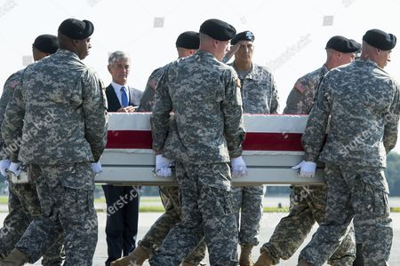Stock Photo of The Remains of Us Army Major General Harold Greene Are Transferred From a C-17 Aircraft by an Army Carry Team As Secretary of the Us Army John Mchugh (back L) and Us Army Chief of Staff General Raymond Odierno (back R) Look on at Dover Air Force Base in Dover Delaware Usa 07 August 2014 Greene Became the First Us General Killed in the Wars in Iraq and Afghanistan After Being Slain by a Gunman That Opened Fire at the Marshal Fahim National Defense University 05 August 2014 United States Dover