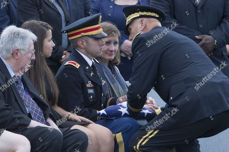 Us Army First Lieutenant Matthew Greene (3l) Son of Deceased Us Army Major General Harold Greene is Presented the Us National Flag by Us Army Chief of Staff General Ray Odierno (r) During the Burial Service in Section 60 of Arlington National Cemetery in Arlington Virginia Usa 14 August 2014 Greene Became the First Us General Killed in the Wars in Iraq and Afghanistan After Being Slain by a Gunman That Opened Fire at the Marshal Fahim National Defense University 05 August 2014 Also in This Picture is General Greene's Family Members (l to R); Father Harold Greene Daughter Amelia Greene and Wife Retired Colonel Susan Myers United States Arlington