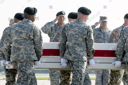 Stock Picture of The Remains of Us Army Major General Harold Greene Are Transferred From a C-17 Aircraft by an Army Carry Team As Us Army Chief of Staff General Raymond Odierno (back C) and Us Air Force Colonel Richard Moore (back R) Salute at Dover Air Force Base in Dover Delaware Usa 07 August 2014 Greene Became the First Us General Killed in the Wars in Iraq and Afghanistan After Being Slain by a Gunman That Opened Fire at the Marshal Fahim National Defense University 05 August 2014 Epa/michael Reynolds Epa/michael Reynolds United States Dover