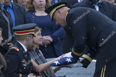Wife of Deceased Us Army Major General Harold Greene Retired Colonel Susan Myers (2l) is Presented the Us National Flag by Us Army Chief of Staff General Ray Odierno (r) Beside General Greene's Son Us Army First Lieutenant Matthew Greene (l) During the Burial Service in Section 60 of Arlington National Cemetery in Arlington Virginia Usa 14 August 2014 Greene Became the First Us General Killed in the Wars in Iraq and Afghanistan After Being Slain by a Gunman That Opened Fire at the Marshal Fahim National Defense University 05 August 2014 United States Arlington