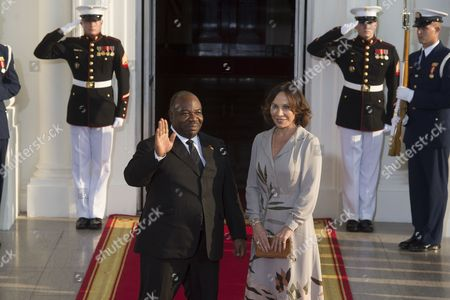 Stock Image of President of Gabon Ali Bongo Ondimba (l) and His Spouse Sylvia Valentin (r) Arrive at the North Portico of the White House in Washington Dc Usa 05 August 2014 on the Occasion of the Us Africa Leaders Summit Us President Barack Obama is Hosting About Fifty African Heads of State and Government For a Dinner at the White House United States Washington