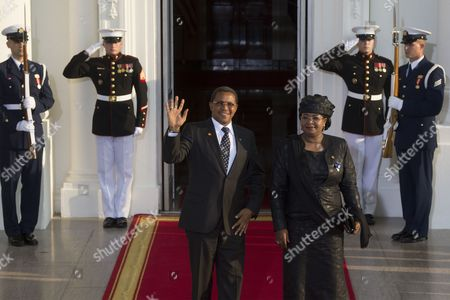 Stock Image of President of Tanzania Jakaya Kikwete (l) and His Spouse Salma Kikwete (r) Arrive at the North Portico of the White House in Washington Dc Usa 05 August 2014 on the Occasion of the Us Africa Leaders Summit Us President Barack Obama is Hosting About Fifty African Heads of State and Government For a Dinner at the White House United States Washington