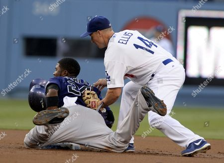 Andrew James Ellis (r) of the Los Angeles Dodgers Puts the Tag on Late As Dexter Fowler (l) of the Colorado Rockies Successfully Steals Second Base in the First Inning at Dodger Stadium in Los Angeles California Usa 12 July 2013 United States Los Angeles