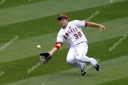 J B Shuck of the Los Angeles Angels Makes a Diving Catch in the Eighth Inning Against the Oakland A's at Angel Stadium in Anaheim California Usa 21 July 2013 the A's Won the Game United States Anaheim