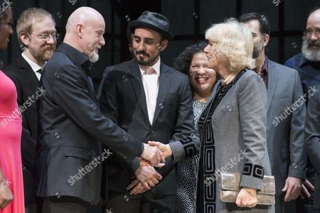 Stock Image of Britain's Camilla (r) Duchess of Cornwall Shakes Hands with Australian Opera and Musical Theatre Performer Anthony Warlow (2-l) on Stage Beside Actors and Cast Members of 'Man of La Mancha' During a Visit to the Shakespeare Theatre Company at Sidney Harman Hall in Washington Dc Usa 18 March 2015 the Prince of Wales and the Duchess of Cornwall Are on Their Third Official Visit to United States United States Washington