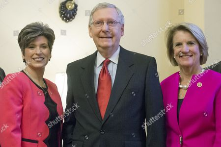Us Senate Republican Leader From Kentucky Mitch Mcconnell (c) Stands Between Rebublican Senators-elect Joni Ernst (l) of Iowa and Shelley Capito (r) of West Virginia; During a Photo Opportunity with Republican Senators-elect on Capitol Hill in Washington Dc Usa 12 November 2014 the Senate and House of Representatives Reconvenes For the First Day Since the 04 November Midterm Elections in Which the Republican Party Made Sweeping Gains Including 8 Seats in the Senate Mitch Mcconnell Will Become the Senate Majority Leader in January 2015 United States Washington