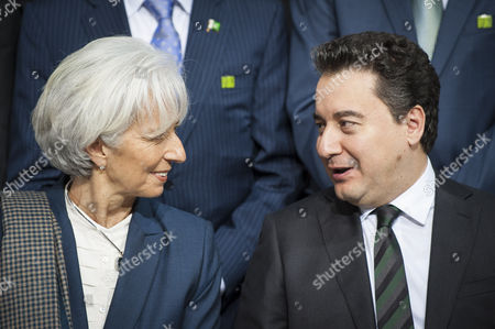 Imf Managing Director Christine Lagarde (l) and Deputy Prime Minister of Turkey Ali Babacan (r) Talk As Members of the International Monetary Fund Committee Pose For a Group Photo During the Imf World Bank Spring Meetings at the Imf Headquarters in Washington Dc Usa 18 April 2015 United States Washington