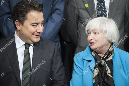 Deputy Prime Minister of Turkey Ali Babacan (l) and Us Federal Reserve Chairman Janet Yellin (r) Talk As Members of the International Monetary Fund Committee Pose For a Group Photo During the Imf World Bank Spring Meetings at the Imf Headquarters in Washington Dc Usa 18 April 2015 United States Washington