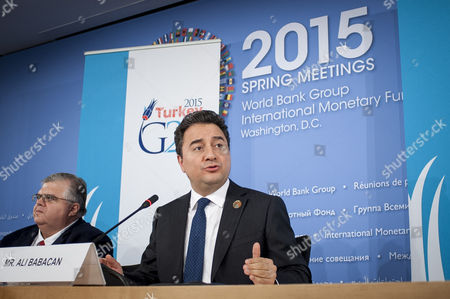 Deputy Prime Minister of Turkey Ali Babacan (r) Next to the Governor of the Bank of Mexico Agustin Carstens Speaks to the Media During a G-20 Press Conference at the International Monetary Fund (imf) Headquarters in Washington Dc Usa 17 April 2015 United States Washington