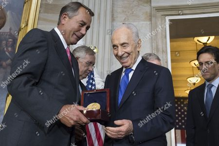 President of Israel Shimon Peres (2-r) is Awarded the Congressional Gold Medal Beside Speaker of the House Republican John Boehner (l) House Majority Leader Eric Cantor (r) and Senate Majority Leader Harry Reid (back C) at the Us Capitol in Washington Dc Usa 26 June 2014 United States Washington