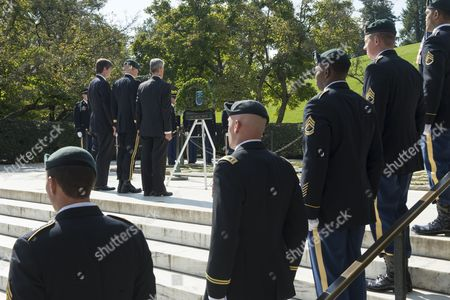 Stock Image of Nephew of Late Us President John F Kennedy William Kennedy Smith (back L); Us Brigadier General Darsie Rogers (back C) and Secretary of the Us Army John Mchugh (back R) Stand Behind Green Berets During a Wreath-laying Ceremony to Honor Jfk's Support of Special Forces Green Berets at Arlington National Cemetery in Arlington Virginia Usa 21 October 2014 Us Army Special Forces Command (airborne) Conducted the Ceremony Using a Wreath in the Shape of a Green Beret Placing It Front of the Eternal Flame at Kennedy's Tomb United States Arlington