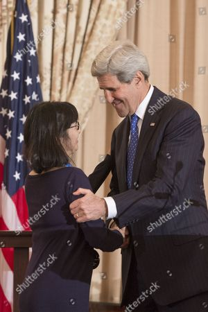 Us Artist Maya Lin (l) a Recipient of the 2014 Medal of Arts Shakes Hands with Us Secretary of State John Kerry (r) During the Art in Embassies' Medal of Arts Luncheon Ceremony at the State Department in Washington Dc Usa 21 January 2015 Us Secretary of State John Kerry Attended the Award Ceremony United States Washington