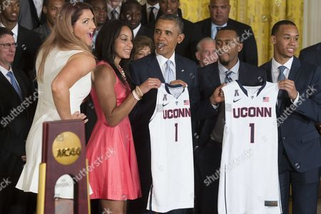 Us President Barack Obama (c) Receives Team Jerseys From Center Stefanie Dolson (l) Point Guard Bria Hartley (2l) Point Guard Shabazz Napier (2r) and Point Guard Ryan Boatright (r) While Welcoming the Ncaa Champion University of Connecticut Huskies to Honor the Men's and Women's Basketball Teams and Their 2014 Ncaa Championships in the East Room of the White House in Washington Dc Usa 09 June 2014 United States Washington