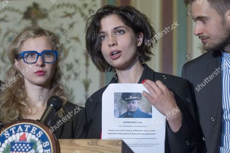 Nadya Tolokonnikova (c) Holds a List of Individuals She and Fellow Member of Pussy Riot Maria Alyokhina (l) Believe Should Have Sanctions Held Against Beside Nadya's Husband Pyotr Verzilov (r) During a News Conference on Capitol Hill in Washington Dc Usa 06 May 2014 Members of the Russian Protest Group Pussy Riot Met with Us Lawmakers to Discuss the State of Human Rights in Russia United States Washington