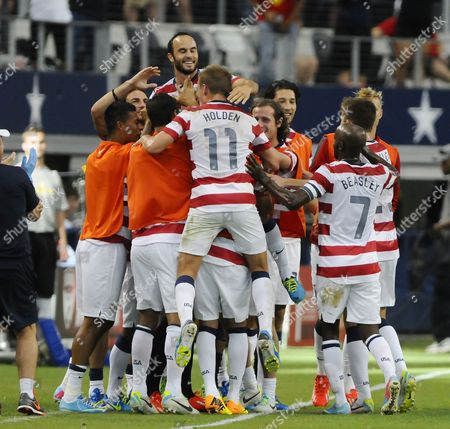 Landon Donovan (l) and Stuart Holden Celebrate with the United States Team After Scoring the Teams Second Goal As Honduras Played the United States in the First Concacaf Gold Cup Semi Final Game at Cowboys Stadium in Arlington Texas Usa 24 July 2013 United States Arlington