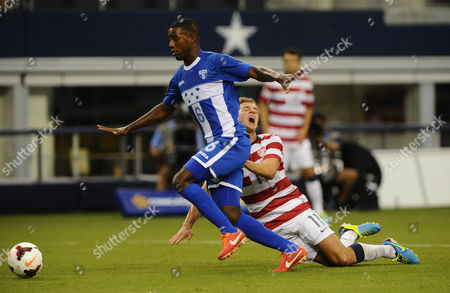 Juan Carlos Garcia (c) of Honduras Blocks out Stuart Holden (r) of the United States in the First Half As Honduras Played the United States in the First Concacaf Gold Cup Semi Final Game at Cowboys Stadium in Arlington Texas Usa 24 July 2013 United States Arlington