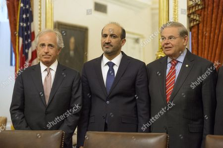 Syrian Opposition Coalition President Ahmad Jarba (c) Stands Beside Senate Foreign Relations Committee Chair Democratic Senator From New Jersey Bob Menendez (r) and Republican Senator From Tennessee and Ranking Member of the Senate Foreign Relations Committee Bob Corker (l) During a Meeting with Members of the Committee on Capitol Hill in Washington Dc Usa 07 May 2014 United States Washington