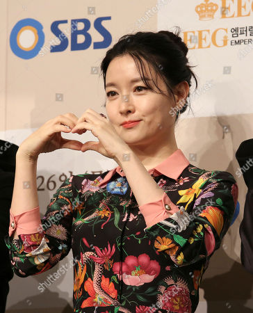 """South Korean actress Lee Young-ae makes a heart shape with her hands during a premiere of her television drama """"Saimdang, Memoir of Colors,"""" in Seoul, South Korea"""