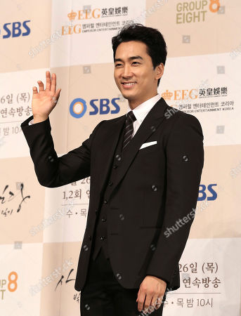 """Stock Photo of South Korean actor Song Seung-heon waves during a premiere of his television drama """"Saimdang, Memoir of Colors,"""" in Seoul, South Korea"""