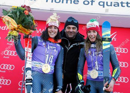 Ski legend Alberto Tomba, center, poses with Italy's Federica Brignone, winner of an alpine ski, women's World Cup giant slalom,left, and third-placed Italy's Marta Bassino, in San Vigilio di Marebbe, Italy