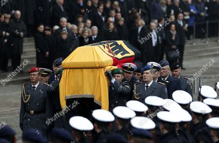 Stock Picture of Members of the military carry the coffin with the late former German president Roman Herzog from the Berlin Cathedral for the military farewell ceremony following the state funeral ceremony in Berlin, Germany, 24 January 2017. Herzog died on 10 January 2017 at the age of 82.