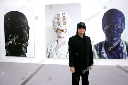 Artist Gottfried Helnwein Poses in Front of Some of His Works Displayed at the Arts Museum of Linz on Wednesday 08 March 2006 a Day Ahead of the Official Opening of the Exhibition Austria Linz