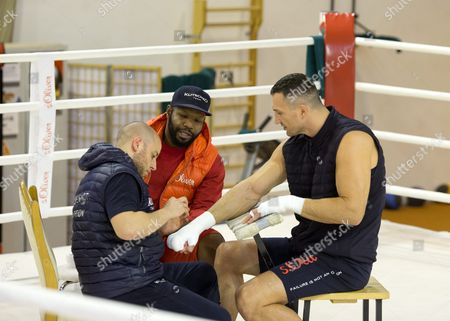 Ukrainian Wba Wbo Ibo and Ibf Heavyweight Boxing World Champion Wladimir Klitschko (r) with Physiotherapist Aldo Vetere (l) and Coach Johnathon Banks (c) During a Training Camp at Hotel Stanglwirt in Going Austria 10 November 2015 Klitschko Will Be Challenged by British Boxer Tyson Fury For the World Heavyweight Crown in Duesseldorf Germany on 28 November 2015 Austria Going