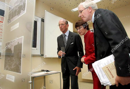 The Duke of Kent (l) Director of the British Council Ruth Sinclair-jones (c) and John Mac Gregor British Ambassador to Vienna Closely View Pictures of an Exhibition After a Plate was Unveiled to Mark the 60th Anniversary of the British Council in Vienna on Tuesday 20 September 2005 Austria Vienna