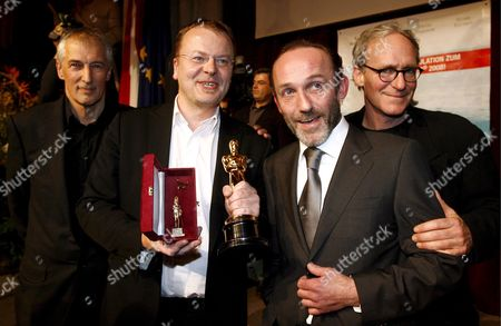 (l-r) Producer Josef Aichholzer Austrian Director and Academy Award Winner Stefan Ruzowitzky Austrian Actor Karl Markovics and Actor August Zirner Pose For Photographers During the 'Gala Zu Ehren Des Oscar-preistraegers Stefan Ruzowitzky' (literally: 'Gala in Honour of Oscar Awardee Stefan Ruzowitzky') at the Townhall in Vienna Austria 05 March 2008 Ruzowitzky Won the Academy Award For Best Foreign Language Film During the 80th Annual Academy For His Movie 'The Counterfeiters ' Austria Vienna