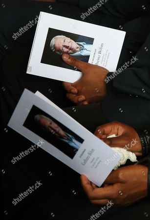 Guests Hold Booklets Bearing the Portrait of Late Austrian Actor Karlheinz Boehm As They Attend a Funeral Service in Salzburg Austria 13 June 2014 the Founder of the Charity Organisation 'Menschen Fuer Menschen' (lit People For People) Karlheinz Boehm Died Aged 86 in Groedig Near Salzburg on 29 May Austria Salzburg