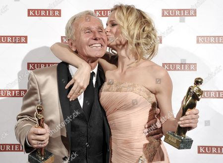 Klaus Eberhartinger (l) and Mirjam Weichselbraun (r) Receive the Romy For the 'Most Popular Talkmaster/showmaster' During the Romy Gala 2012 at the Hofburg Palace in Vienna Austria 21 April 2012 the Austrian Public was Asked to Choose All Award Winners in a Public Vote in Seven Categories Austria Vienna