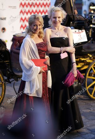 Widow of Austrian-swiss Actor Maximilian Schell Iva Schell and German Actor Sunnyi Melles (r) Arrive For the Opening Ceremony of the Summer Ball Fete Imperiale at the Spanish Riding School in Vienna Austria 27 June 2014 Austria Vienna