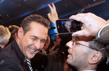 Freedom Party's (fpo) Leading Candidate Heinz Christian Strache and the Freedom Party General Secretary Herbert Kickler (r) Celebrate After the Regional Elections in Vienna Austria on 10 October 2010 Media Reports State That Projections Suggest That the City's Current Leader Michael Haeupl May See His Social Democrats Lose Their Absolute Majority Because of a Surge in Support For the Former Party of the Late Anti-immigration Politician Joerg Haider Austria Vienna
