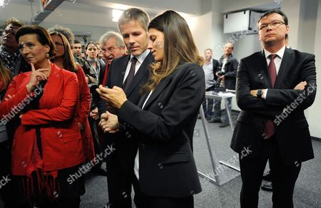 Party Officials (l-r) Gabriele Heinisch-hosek Josef Ostermayer Laura Rudas and Norbert Darabos of the Austrian Social Democratic Party Spoe Wait While Watching Unoffial Results Coming in at the Party Headquarters in Vienna Austria 29 September 2013 According to Unofficial Results the Spoe Will Remain the Strongest Party in Austria's Parliament the Country's Ruling Coalition of Social Democrats and Conservatives Hold on to a Narrow Majority in Parliamentary Elections But Lose Ground to Far-right and Eurosceptic Parties According to Projections on 29 September 2013 Early Evening Austria Vienna