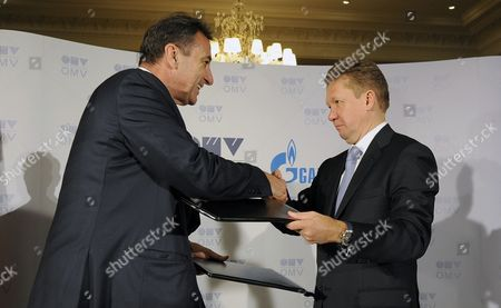 Stock Image of Omv Ceo Gerhard Roiss (l) and Gazprom Ceo Alexei Miller Shake Hands During Their Meeting to Sign the South Stream Gas Pipeline-contract in Vienna Austria 24 June 2014 Austrian Oil and Gas Group Omv Has Signed a Deal with Russian Gas Provider Gazprom on Building the Austrian Stretch of the South Stream Pipeline Which Would Supply Russian Gas Through the Balkans and Southern Europe Directly to Europe Bypassing the Current Transit Route Through Ukraine Austria Vienna