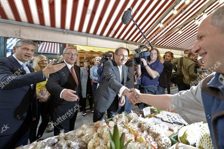 (l-r) Austrian Finance Minister Michael Spindelegger Top Candidate For the Conservatives in the Eu Elections Jean-claude Juncker and Vice President of the European Parliament Othmar Karas Shake Hands During a Visit to the Naschmarkt in Vienna Austria 07 May 2014 the Elections For the Eu Parliament Take Place on 25 May 2014 Austria Vienna