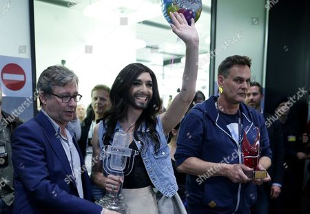 (l-r) Orf-chief Alexander Wrabetz Eurovision Song Contest 2014 Winner Conchita Wurst of Austria and Her Manager Rene Berto Pose For the Media After Her Arrival at the Vienna International Airport in Schwechat Austria 11 May 2014 Austria Schwechat
