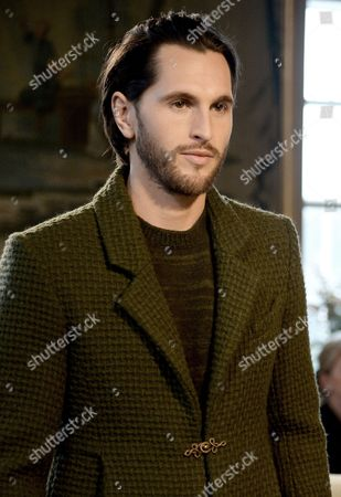 British Model Jake Davies Presents a Creation by German Designer Karl Lagerfeld For Chanel Fashion House During the 'Chanel Metiers D'art Show' Held at the Hotel Schloss Leopoldskron in Salzburg Austria 02 December 2014 Since 2002 the Show Celebrates the Craftsmanship of Chanel's Artisan Partners Austria Salzburg