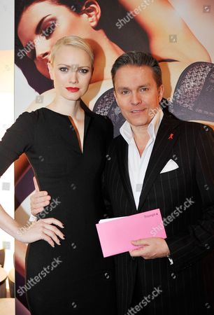 German Model Franziska Knuppe (l) and Austrian Entertainer Alfons Haider Pose During a Press Conference and the Presentation of New Triumpf Collection 'The Little Black Dress' in Vienna Austria 07 February 2013 Knuppe Will Attend the Vienna Opera Ball Tonight Austria Vienna