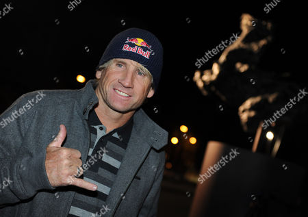 Us Windsurf Legend Robby Naish Arrives Prior to a Tv Show with German Formula One World Champion Sebastian Vettel (not in Picture) in Hangar-7 in Salzburg Austria 15 November 2010 Sebastian Vettel Became the Youngest Formula One Champion in History with Victory From Pole Position in the Season-ending Abu Dhabi Grand Prix on November 14 Austria Salzburg