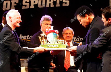 Stock Picture of Boxing Legend Muhammad Ali (2nd R) Cuts a Birthday Cake Watched by Former Flying Pickets Singer Gary Howard (l) Long Jump Athlete Bob Beamon (hidden) Swimmer Mark Spitz Motorsport Icon Giacomo Agostini (3rd R) and Kulm World Cup Organizer Hubert Neuper (r) During the Gala 'Moments of Sports' Saturday 14 January 2006 in Bad Mitterndorf Austria Bad Mitterndorf